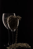 Glasses of champagne and a bottle of wine on a black background Stock Photo