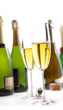 Glasses of champagne with bottles on white royalty free stock images