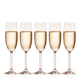 Glasses of champagne with bubbles, isolated on Royalty Free Stock Images