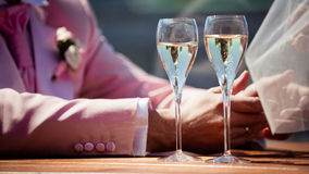 Glasses of champagne with bubbles and lovers Royalty Free Stock Image