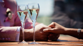 Glasses of champagne with bubbles and lovers Stock Photo