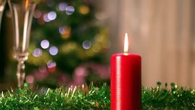 Christmas Candle and champagne glasses close up stock video footage