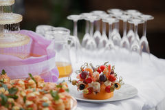 Glasses with champagne. catering banquet table. a lot of snacks and canapes Royalty Free Stock Photos