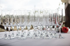 Glasses with champagne. catering banquet table. a lot of snacks and canapes Royalty Free Stock Images