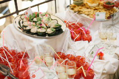 Glasses with champagne. catering banquet table. a lot of snacks and canapes Royalty Free Stock Image