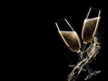 Glasses of champagne, celebration theme. Glasses of champagne with splash, celebration theme Royalty Free Stock Images