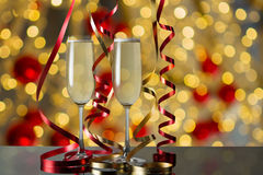 Glasses of champagne for celebrations with abstract bokeh. Stock Photo