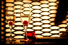 Glasses with champagne and cherry Royalty Free Stock Photos