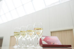 Glasses of champagne and chocolates Stock Image