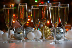 Glasses of champagne and christmas balls Stock Images