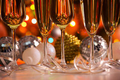 Glasses of champagne and christmas balls Stock Photos