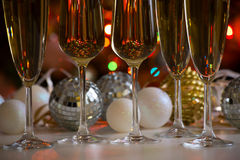Glasses of champagne and christmas balls Royalty Free Stock Photography