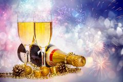 Champagne glasses on sparkling background. Glasses with champagne and Christmas decoration against fireworks and holiday lights - Celebrating the New Year Royalty Free Stock Photography