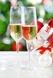 Glasses of champagne and Christmas decorations Royalty Free Stock Images