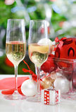 Glasses of champagne and Christmas decorations Royalty Free Stock Photo