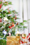 Glasses of champagne and Christmas decorations Stock Photos