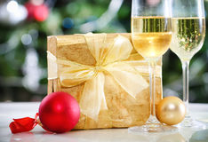 Glasses of champagne and Christmas decorations Royalty Free Stock Image