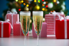 Glasses of champagne and Christmas gifts Royalty Free Stock Images