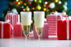 Glasses of champagne and Christmas gifts Stock Photo