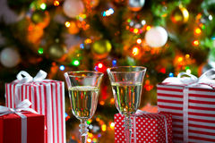 Glasses of champagne and Christmas gifts Royalty Free Stock Photo