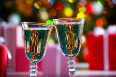 Glasses of champagne and Christmas gifts Stock Image