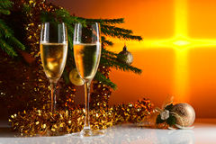 Glasses with champagne and Christmas ornaments Stock Images