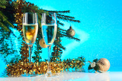 Glasses with champagne and Christmas ornaments Stock Photos