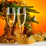 Glasses with champagne and Christmas ornaments Royalty Free Stock Photos
