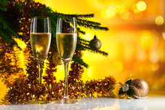 Glasses with champagne and Christmas ornaments Stock Photography
