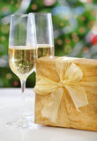 Glasses of champagne and Christmas present Stock Photo