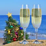 Glasses of champagne and Christmas tree Royalty Free Stock Photos