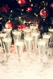 Glasses of champagne with Christmas tree background. Many glasses for party. Holiday season background. Traditional red and green stock photos