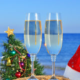 Glasses of champagne and Christmas tree Stock Photos