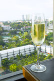 Glasses of champagne. On city backgrounds Stock Photos