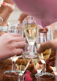 Glasses of champagne clinking Royalty Free Stock Image