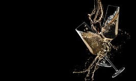 Glasses of champagne clinking together and splashing on black. Background stock image