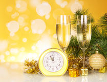 Glasses of champagne with clock and Christmas Royalty Free Stock Photography