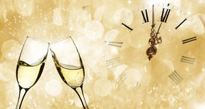 Glasses with champagne and clock close to midnight Royalty Free Stock Images
