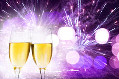 Glasses with champagne and clock close to midnight Stock Photography