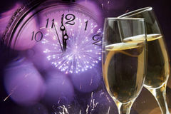 Glasses with champagne and clock close to midnight Royalty Free Stock Photos