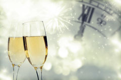 Glasses with champagne and clock close to midnight Royalty Free Stock Photo