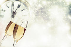 Glasses with champagne and clock close to midnight Royalty Free Stock Photography
