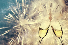 Glasses with champagne and clock close to midnight Stock Photo