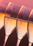 Glasses of champagne. Close up glasses of champagne with sunset background Stock Photo