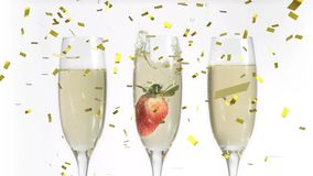 Glasses of champagne and confetti. Digital composite of glasses of champagne with a strawberry in one while gold confetti fall in the screen stock video
