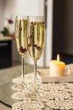 Glasses of Champagne. With cranberries royalty free stock image