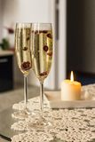 Glasses of Champagne. With cranberries stock images
