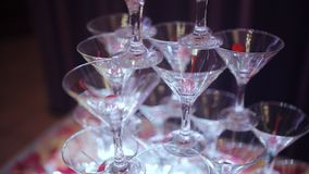 Champagne pyramid for parties with cherries. Glasses with champagne and dry ice in the form of a slide. Smoke of stock footage