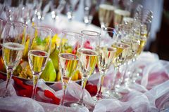 Glasses of champagne on festive table Stock Photos