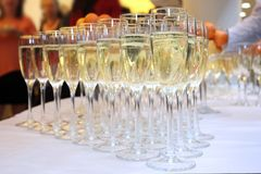 Glasses of champagne on festive table stock images